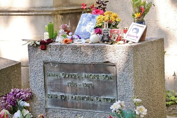 a closeup of Jim Morrison\'s gravestone