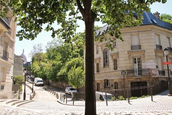 a quiet cobblestone Parisian street