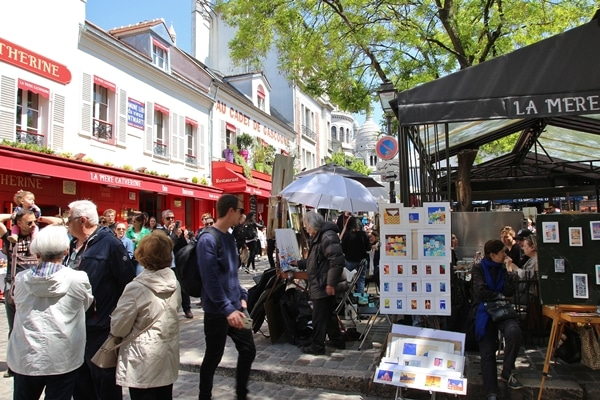 a bustling Parisian square filled with artists and tourists