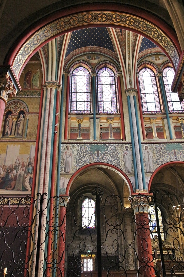 frescoes on church walls with tall windows