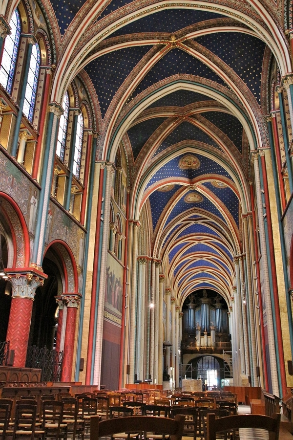 large church interior with brightly colored ceiling and walls