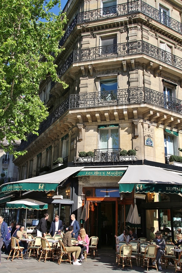 exterior of a Parisian bistro with green awning