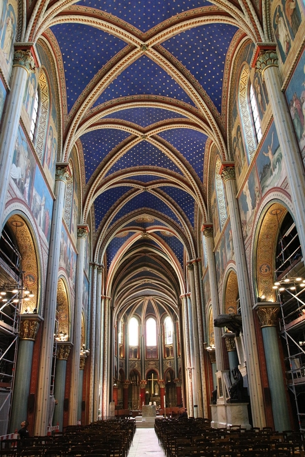 interior of a large church with blue vaulted ceiling