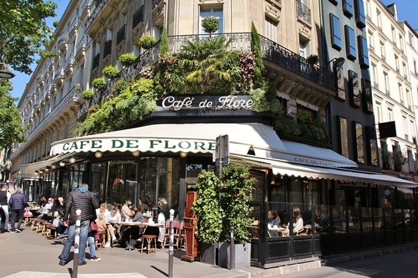 exterior of a Parisian cafe with white awning