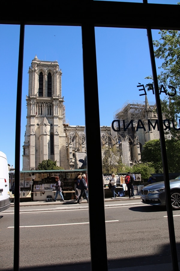 view through a window of Paris\'s Notre Dame Cathedral