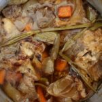 Homemade beef stock cooking in a stockpot