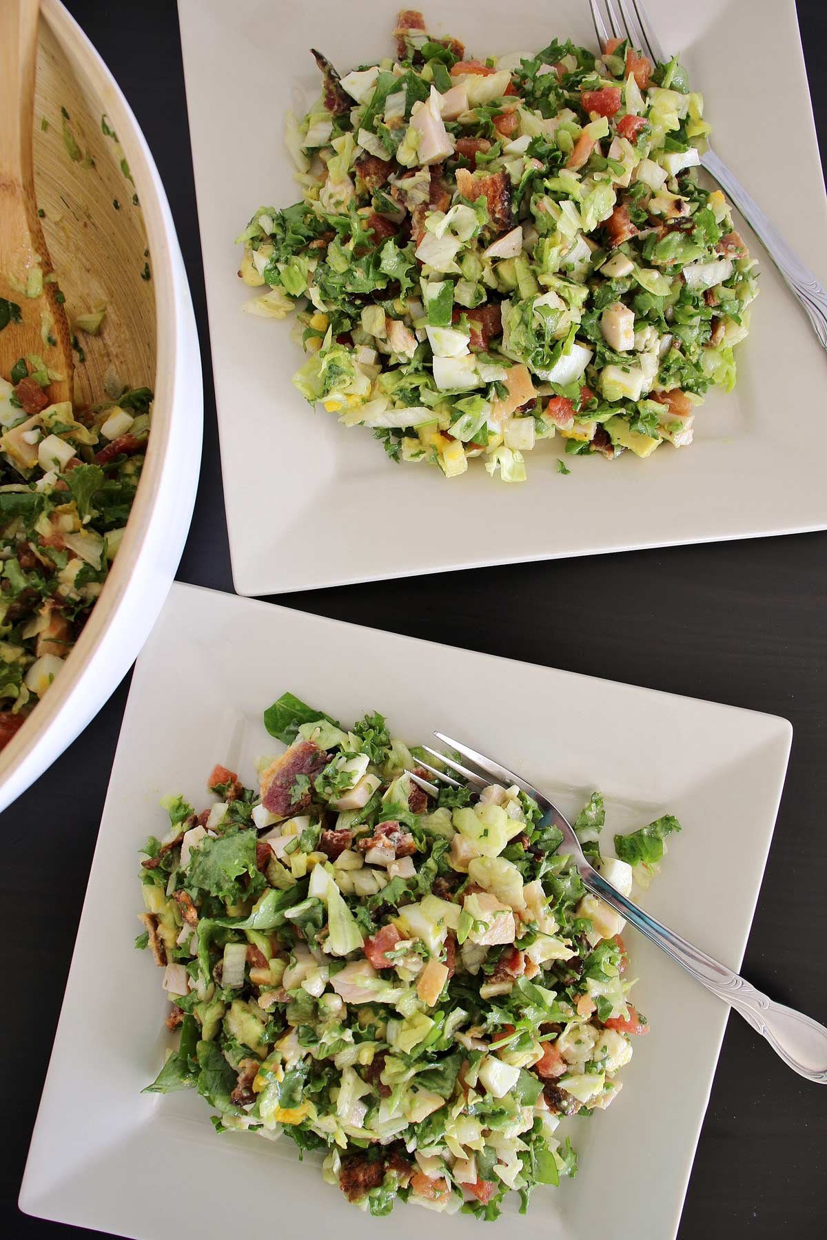 Brown Derby Salad tossed and served on 2 square plates.