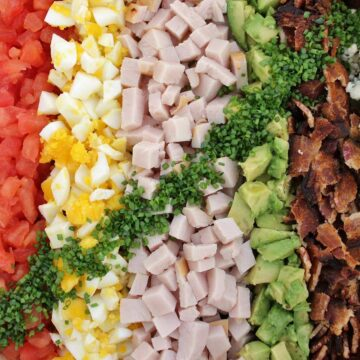 Hollywood Brown Derby Cobb salad with colorful toppings arranged in perfect rows.