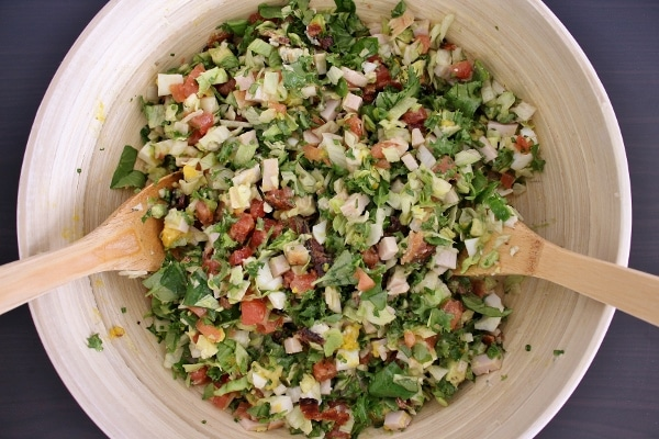 Tossed Hollywood Brown Derby Cobb Salad in a wooden mixing bowl