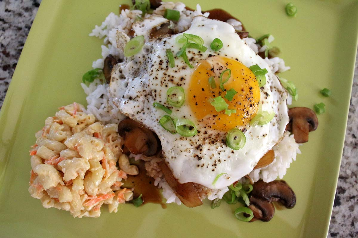 Loco Moco (white rice, burger patty, gravy, and fried egg) with scoop of macaroni salad.