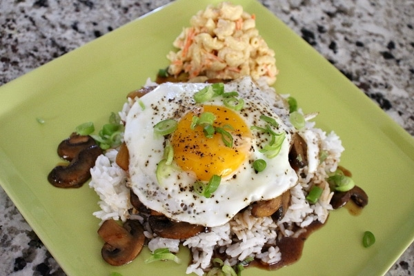 A loco moco lunch plate served with a scoop of Hawaiian mac salad