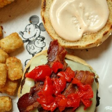 overhead view of a burger with bacon and pickled cherry peppers