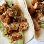 Chicken tacos with salsa and guacamole