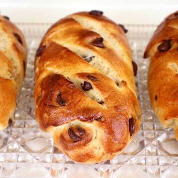Three small loaves of Viennoise (Vienna bread) with chocolate chips