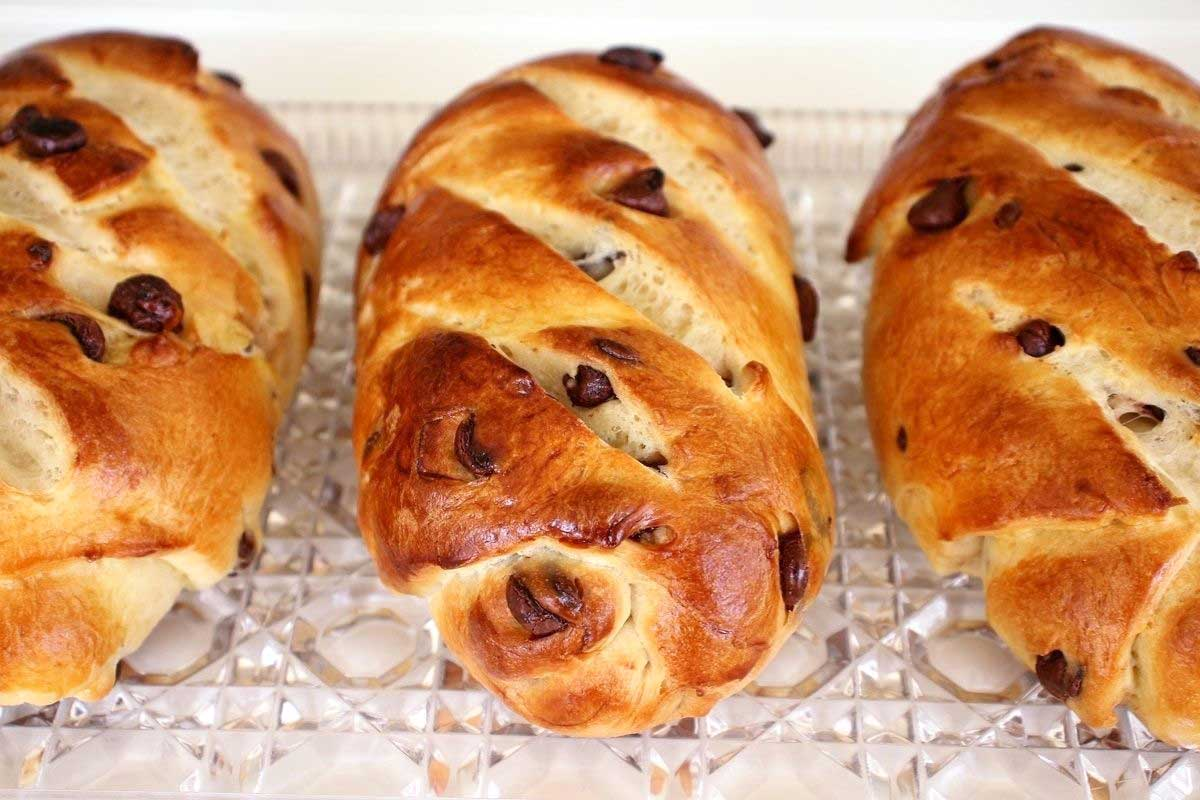 Three small loaves of Viennoise (Vienna bread) with chocolate chips.