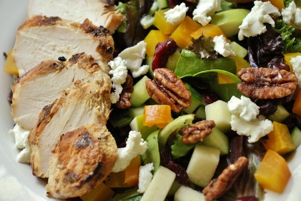 closeup of a salad with grilled chicken and vegetables
