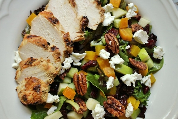 overhead view of salad with chicken, golden beets, and goat cheese
