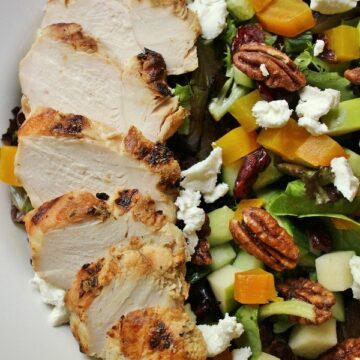 Salad with grilled chicken, golden beets, goat cheese, pecans, dried cranberries, cucumber