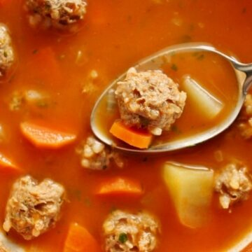 Meatball soup with potatoes and carrots in a vintage bowl