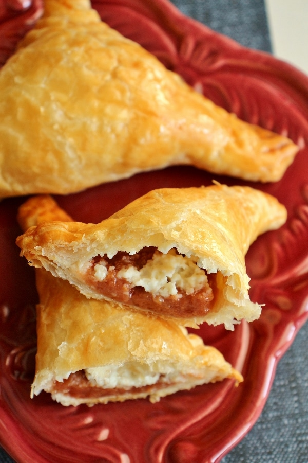 A close up of guava and cheese pastries on a small plate