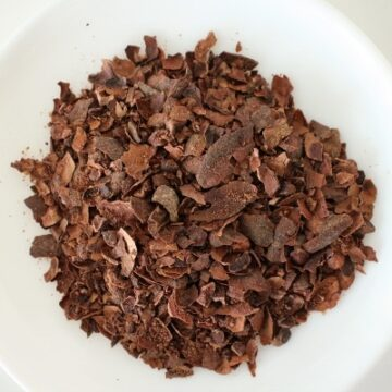 Cacao tea on a small white plate