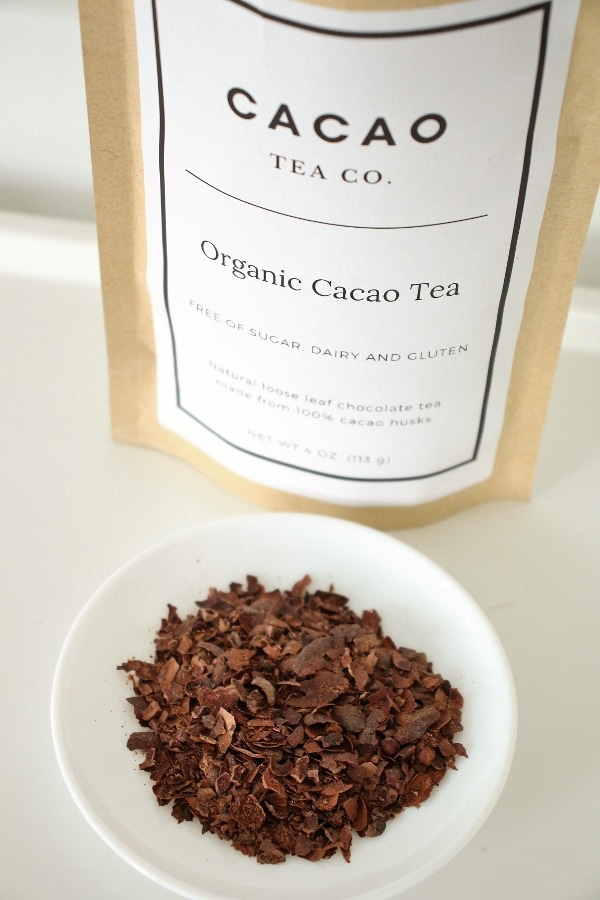 A bag of Cacao tea and a small plate with unbrewed cacao tea husks