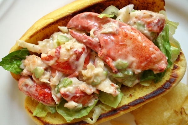 A close up of a lobster roll