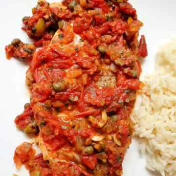 Veracruz style fish with tomato, caper, and olive sauce with side of rice