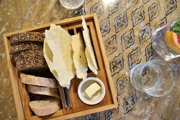 a bread board on an ornate table top