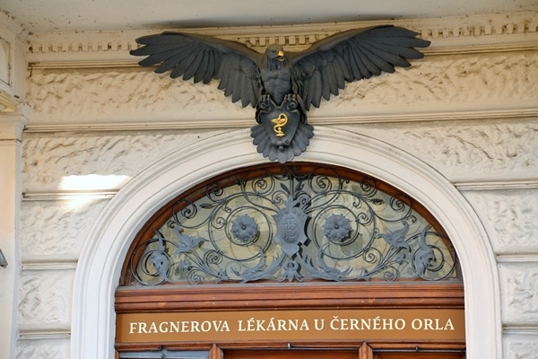 a black eagle statue over a doorway