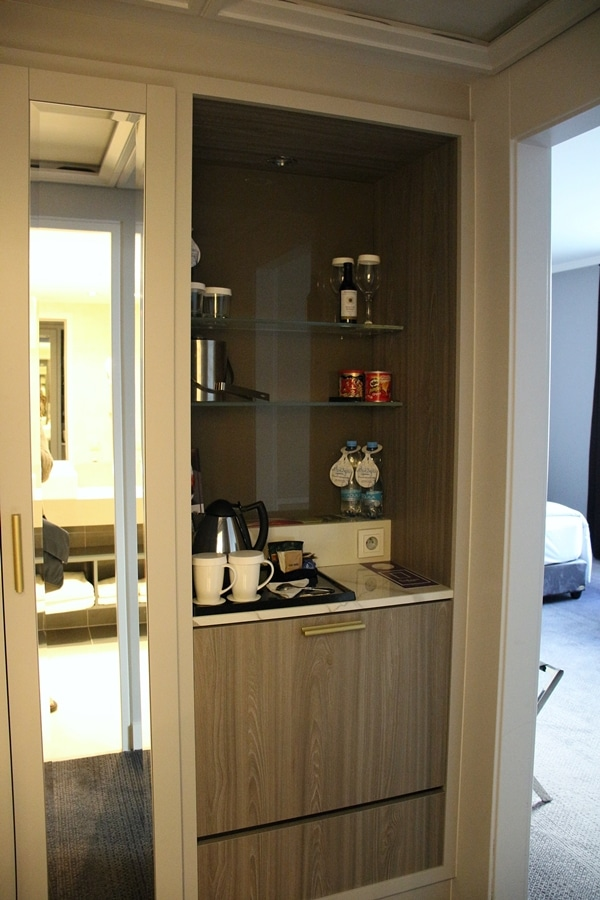 a coffee maker and mini fridge in a hotel room