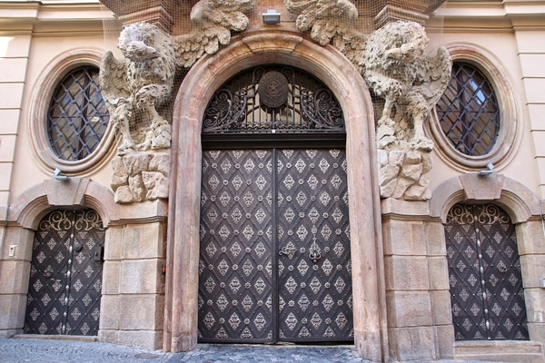 an ornate door on a stone building