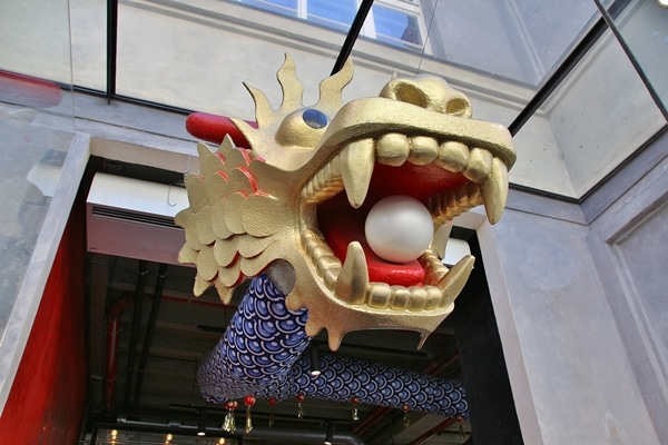 a dragon\'s head with a pearl in its mouth