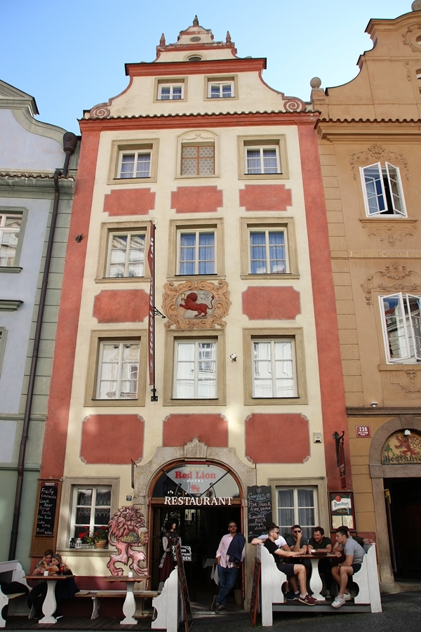 a tall building with an image of a red lion on the facade