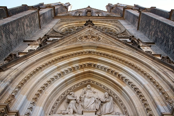 view looking up on the stone facade of a church
