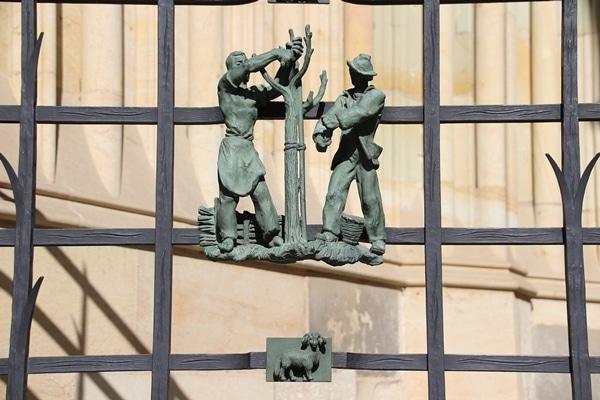 a metal figurine on a gate