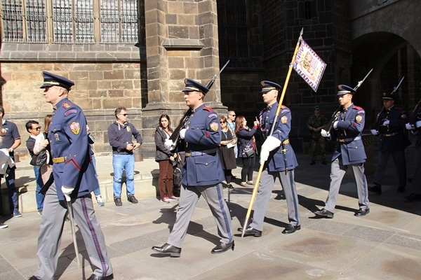 soldiers in blue uniforms marching in a line
