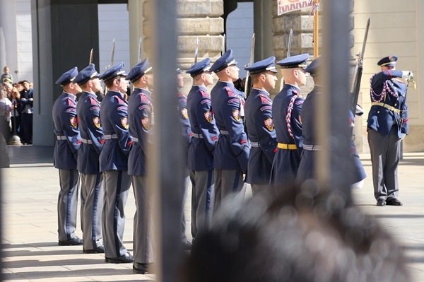 closeup of a row of soldiers in blue uniforms