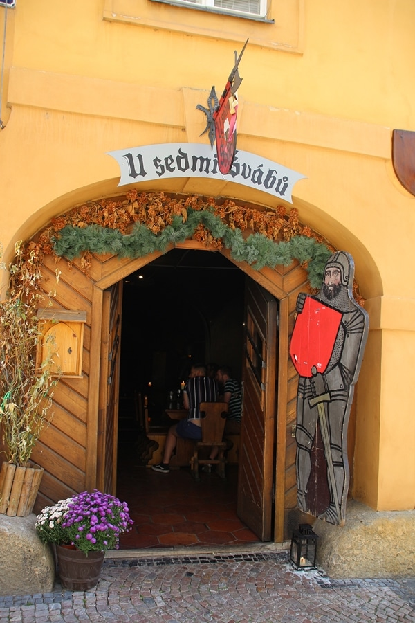 the entrance to a medieval themed restaurant