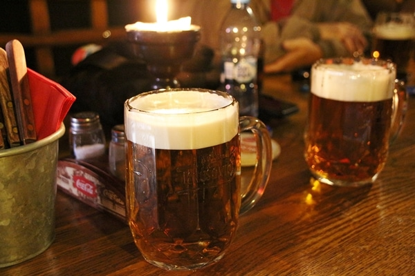 a glass of beer on a wooden table