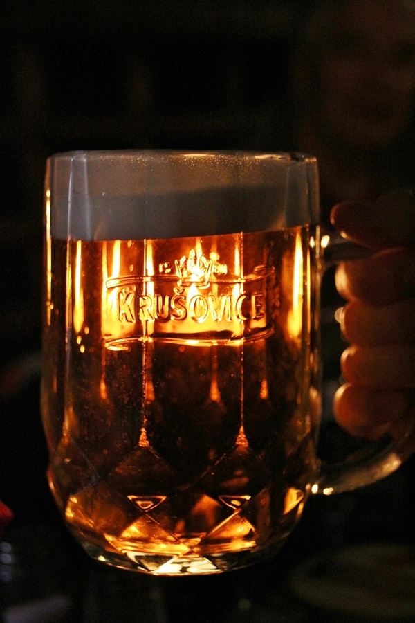 light shining through a glass of beer