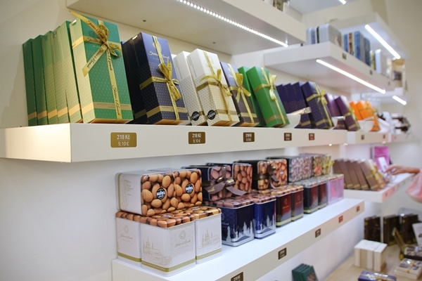the interior of a chocolate shop with boxes of chocolate lined up