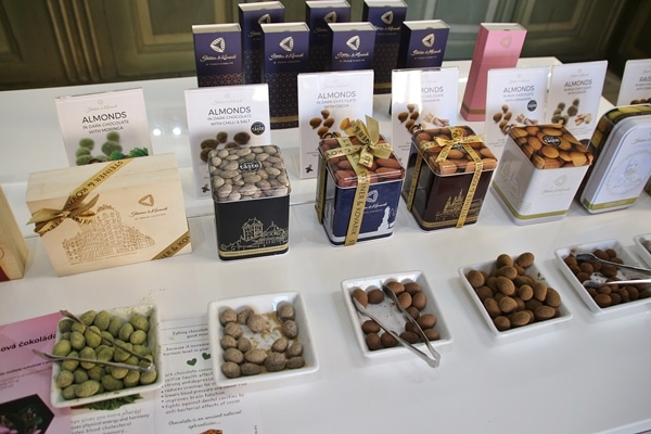 a sampling of chocolates in square plates on a counter
