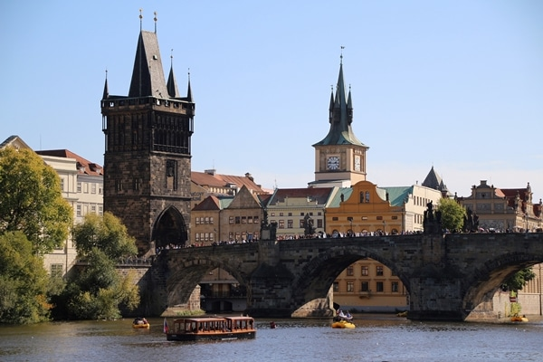 a stone bridge over a river with a tower at one end