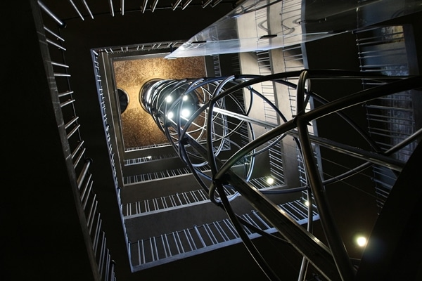 view looking up an elaborate glass elevator shaft