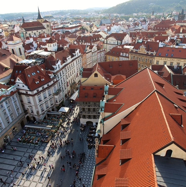 red roofed buildings in Prague viewed from a tall tower