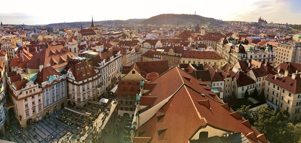Prague\'s red roofed buildings viewed from a tall tower