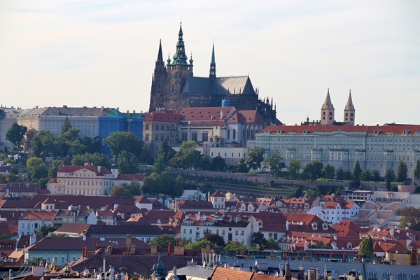 A view of Prague Castle with large buildings around it