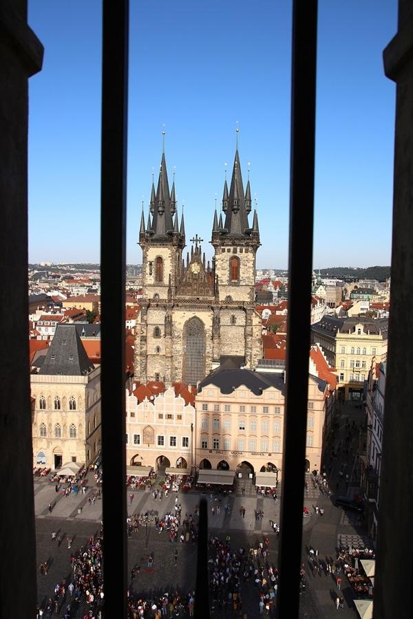 a large church viewed through a barred window