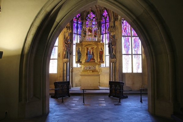 a small chapel interior with stained glass windows